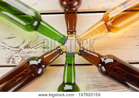 Beer bottles decoration close up. Collection from group of bottles on old wooden background.