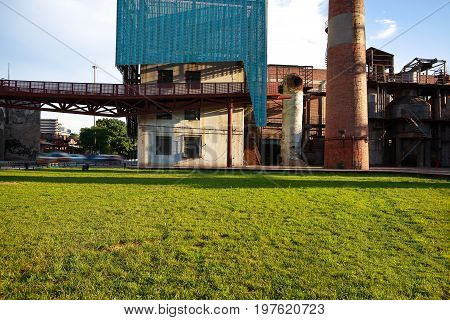 Empty Grass With Old Steel Steelworks Of Pipelines