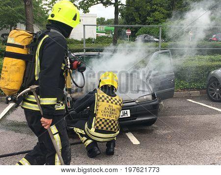 SWINDON UK - JULY 29 2017: Car Fire ASDA West Swindon Firemen attend a car fire in the ASDA carpark in West Swindon