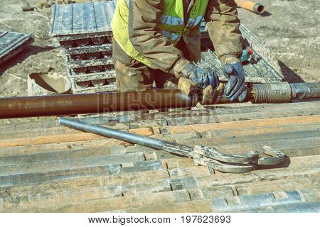 Drilling Worker Tightens Drill Pipe 2