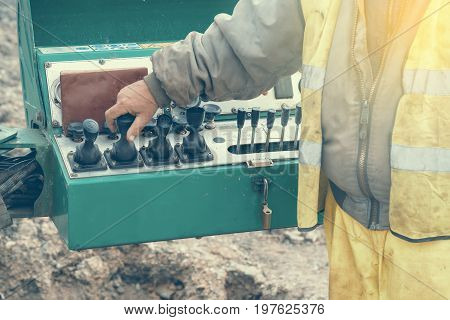 Operator Hand On Controls Of Core Drilling Machine 2