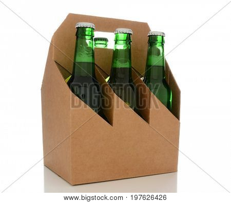 A 6 pack plain brown cardboard beer carrier on white with reflection. The carrier is blank ready for your copy.