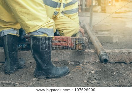 Workers At Site Take Out Drill Core Sample