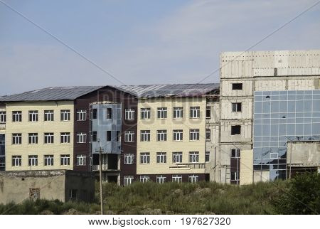 Unfinished abandoned modern building, facade, Central Asia