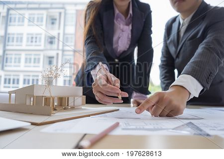 Engineer sketching architectural project on blueprint and laptop engineering concept architectural concept