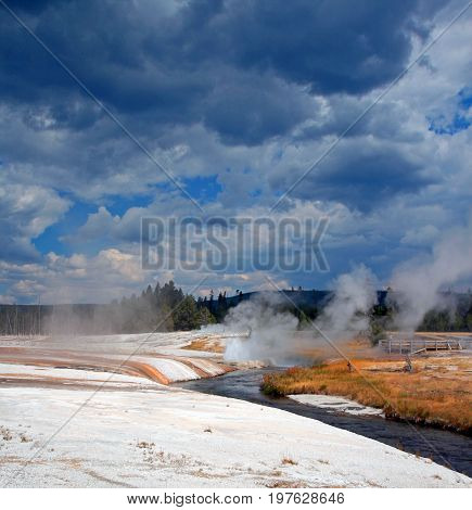 Iron Spring Creek Flowing Past Cliff Geyser In Black Sand Geyser Basin In Yellowstone National Park