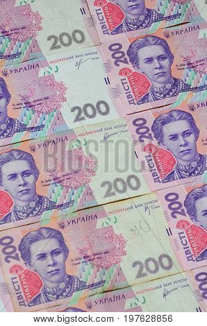 A Close-up Of A Pattern Of Many Ukrainian Currency Banknotes With A Par Value Of 200 Hryvnia. Backgr