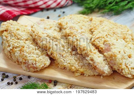 Raw Chicken Fillet In Bread Crumbs Prepared For Cook