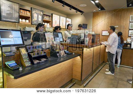 INCHEON, SOUTH KOREA - CIRCA MAY, 2017: Starbucks at Incheon International Airport. Starbucks Corporation is an American coffee company and coffeehouse chain.