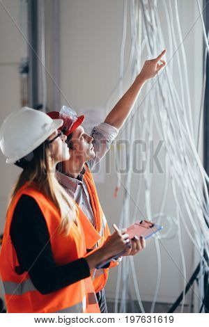 Maintenance Engineers Checking Cables, Indoors Image, Toned Image