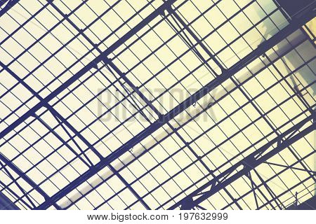 Huge vintage skylight window -  industrial architectural background.  Retro style filtered image