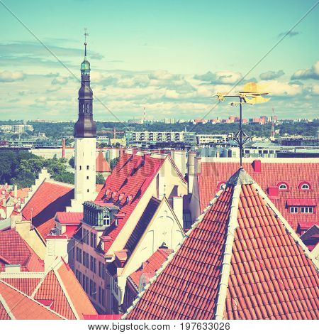 Cityscape of Tallin with with city halls tower and rooster vane, Estonia. Retro style filtred image