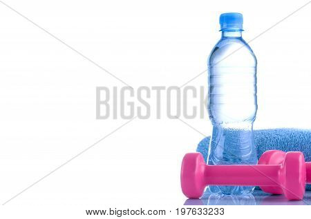 Fitnes symbols - Pink dumbbells a bottle of water and a towel. The concept of a healthy lifestyle.