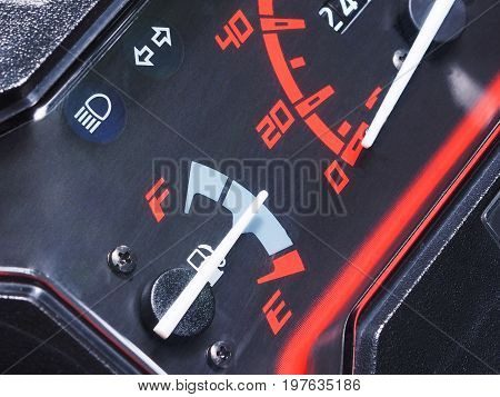 Close up fuel gauge on motorcycle dashboard