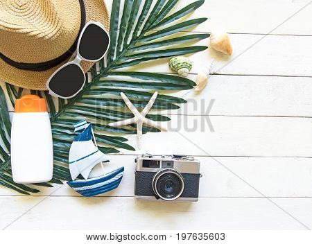 Summer Fashion woman big hat and accessories in the beach. Tropical sea.Unusual top view white wood background. Summer Concept.