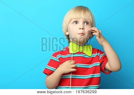 Portrait Of Little Boy With Paper Bow Tie On Blue Background