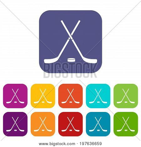 Crossed hockey sticks and puck icons set vector illustration in flat style in colors red, blue, green, and other