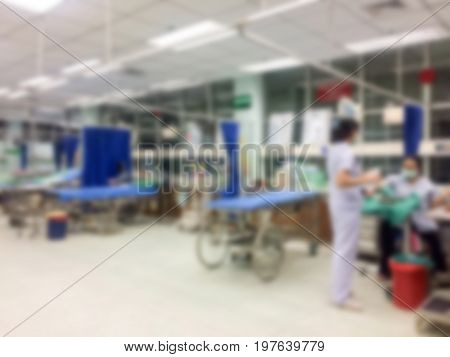 Blurry hospital emergency room interior for background. Blurred image of nurse in emergency room use for background.