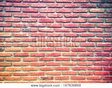 Red brick wall texture grunge background textured for vignetted corners or interior design.