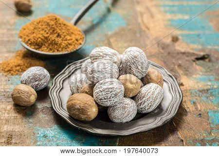 Nutmeg Powder. Macro View Whole Nuts And Grated Muscat Nuts.