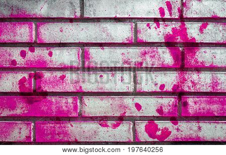 Pink handprints and blotches of paint on grunge wall. Background for creative content design t-shirts and more. Fully editable.