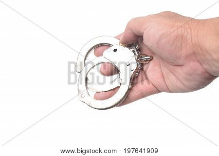 Man hand with handcuffs isolated in white