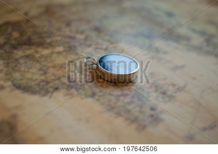Compass on old vintage world map,vintage style,selective focus. poster