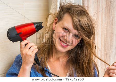 Beautiful Young Woman Dries Hair With Hair Dryer
