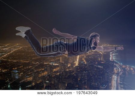 I am a super hero. Confident guy with beard enjoying his flight under metropolis. Double exposure with him and urban view