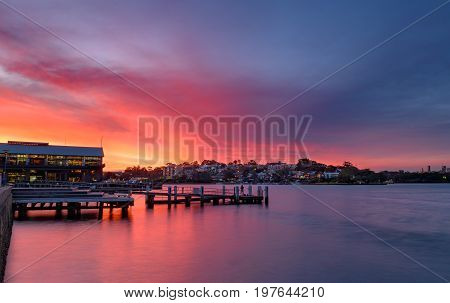 Sunset at Wharf on Darling Harbour with Fishingman Sydney Australia