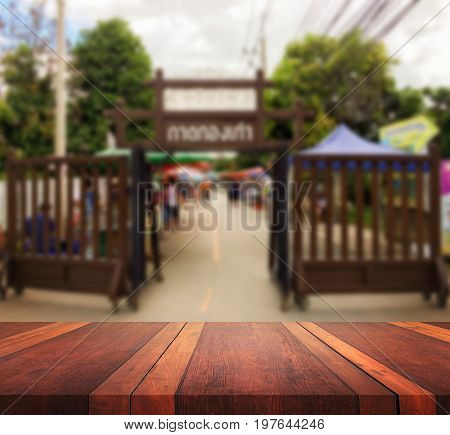 Empty brown wooden table surface and outdoor Flea Market blur background image, for product display montage,can be used for montage or display your products.