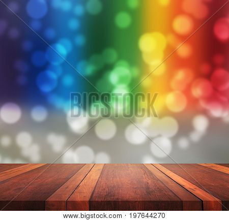 Empty brown wooden table surface blur background with colorful bokeh image, for product display montage,can be used for montage or display your products.