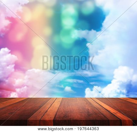 Empty wooden table and abstract background.Empty brown wooden table surface and blur background with bokeh image, for product display montage,can be used for montage or display your products.
