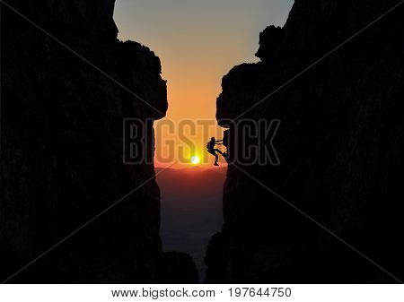 Climber between two large rocks & professional climber