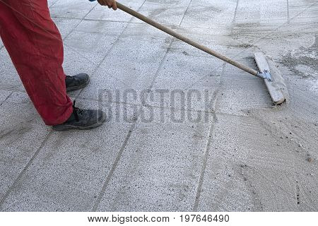 Install Polymeric Sand By Brooming