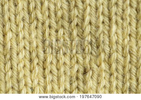 A beautiful closeup of a hand knitted warm and soft wool pattern. Soft socks or scarf of natural wool. Colorful pattern.