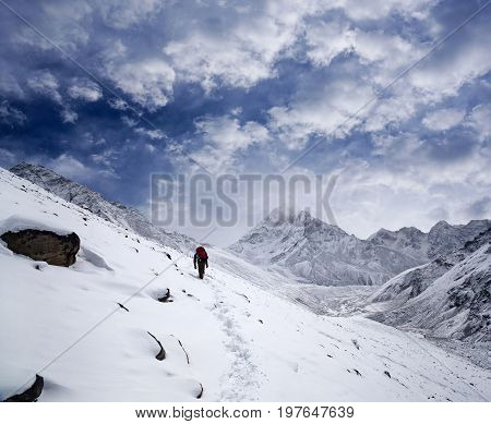 An unidentified tourist walking on the road to Everest Base Camp in Sagarmatha National Park, Nepal, Himalayas