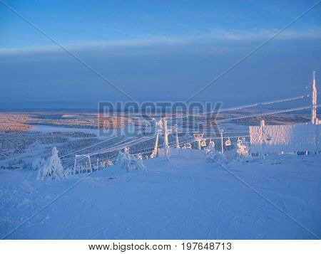 Icy ski-lifts in a skiing resort in Finnish Lapland