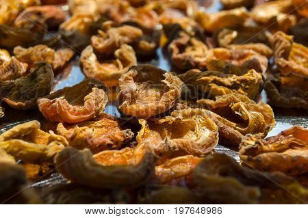 Organic apricots left to dry on the sun, dried apricots dried to make companions,