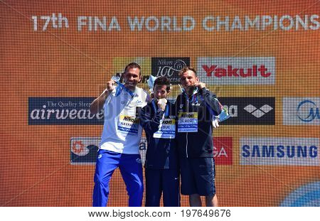 Budapest Hungary - Jul 30 2017. NAVRATIL Michal (CZE) LO BUE Steve (USA) and DE ROSE Alessandro (ITA) the winners of the Men's High Diving Competition. FINA High Diving World Campionships.