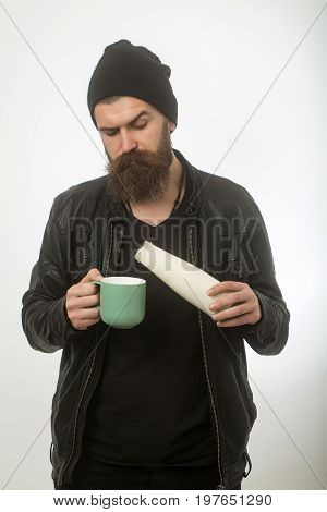 Hipster In Hat With Yoghurt And Cup.