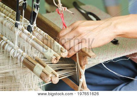 Close Up Of Asian Man Hand Weaving