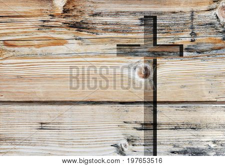 Brown old christian religion symbol cross shape as sign of belief on a grungy textured church wall or rustic aged background, with copy space for spirituality or resurrection design