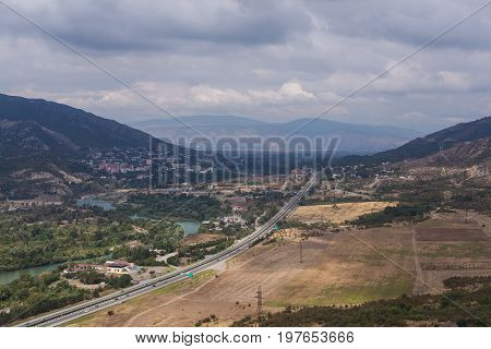 Mountain town with road and lake Horizontal image