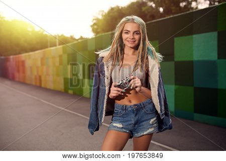 Hipster Woman Taking Photos With Retro Film Camera. Outdoor Street Photo Of Photographer Woman.