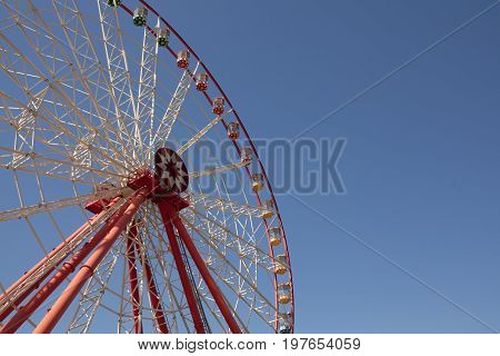 Carnival Ferris Wheel With Clean Skies With Empty Space Close Up Shot Of Half Of A Ferris Wheel
