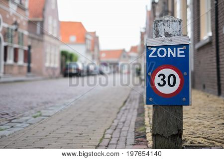 Sign zone of maximum speed 30 on old town street