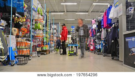 brasov romania - march 5th 2015: customer inside the decathlon sports equipment store in brasov romania. shot taken on march 5th 2015