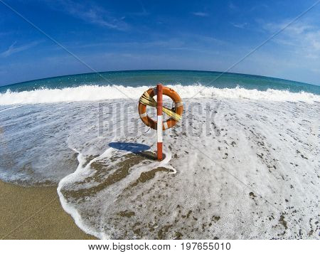 The Waves Reach The Lifebuoy In The Middle Of The Beach