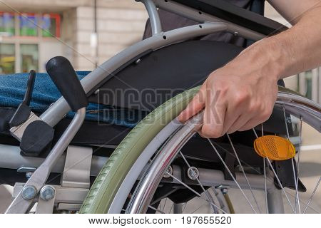 Handicapped Disabled Man Sitting On Wheelchair Outdoors On Stree